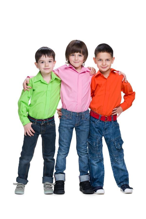 Tre ragazzi dei giovani di modo fotografia stock libera da diritti