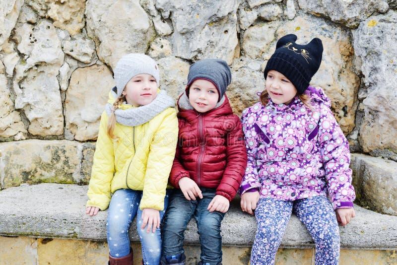 Tre roliga barn royaltyfria foton