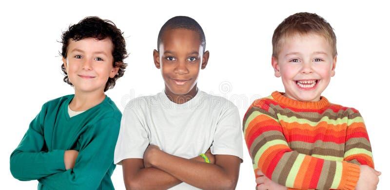 Tre roliga barn arkivfoton