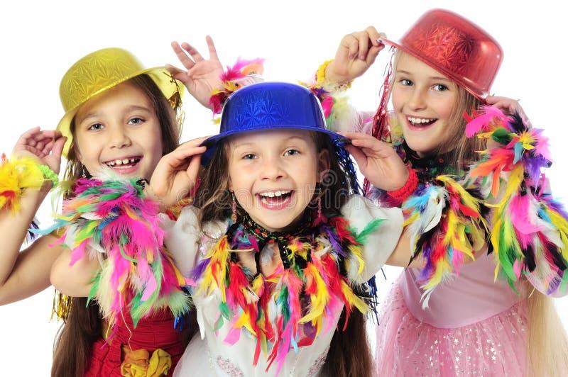 Tre roliga karnevalungar royaltyfria bilder
