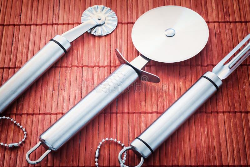 Tre rostfritt stålkökhjälpmedel royaltyfri bild