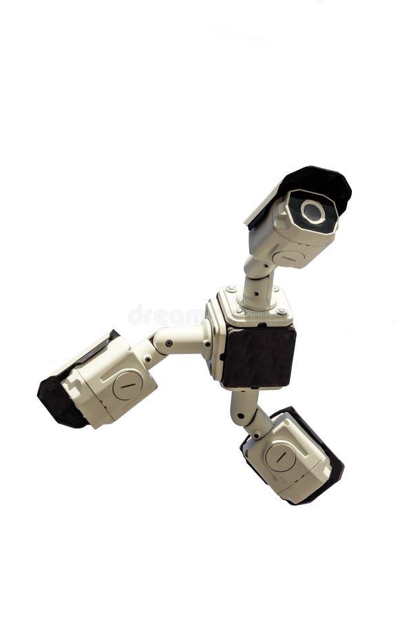 Tre säkerhetscctv-kameror på vit bakgrund arkivfoton