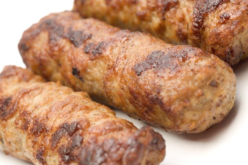 Tre salsiccia a bassa percentuale di grassi di maiale e del tacchino fotografie stock libere da diritti