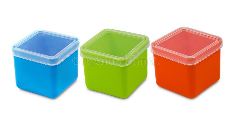 Tre scatole vuote di plastica nel fondo bianco immagini stock