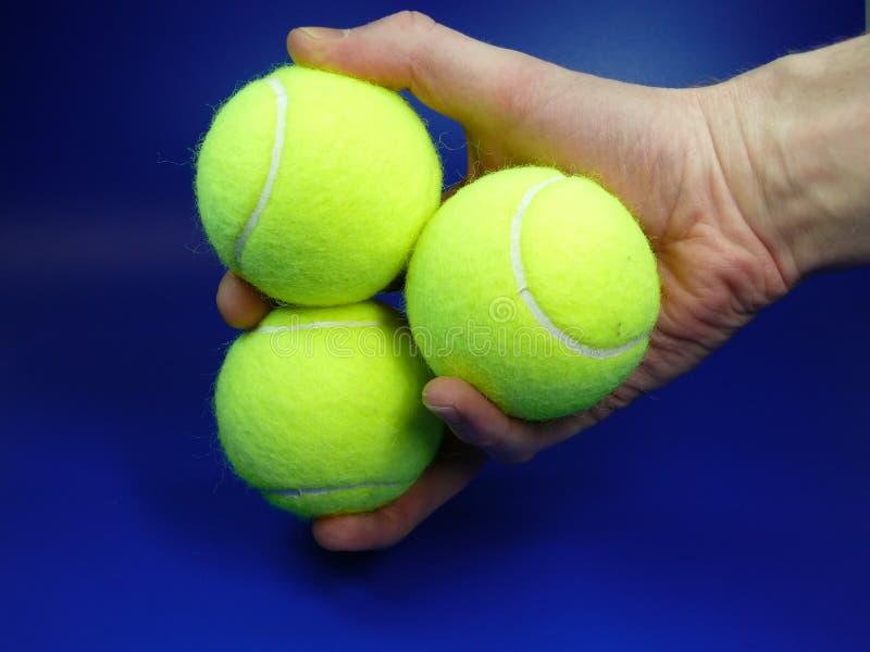 Tre sfere di tennis immagine stock