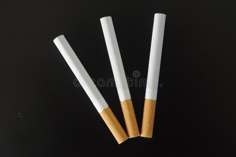 Tre sigarette fotografia stock libera da diritti