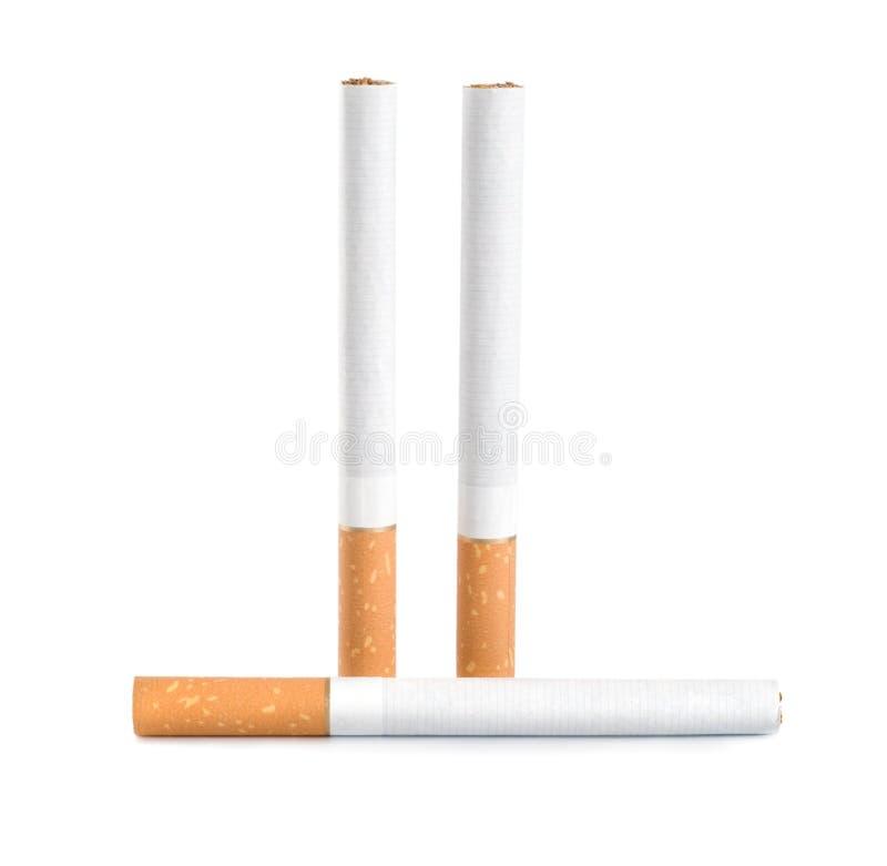 Tre sigarette (percorso) immagine stock
