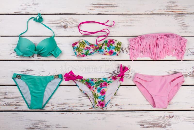 Tre sorter av färgrika baddräkter fotografering för bildbyråer