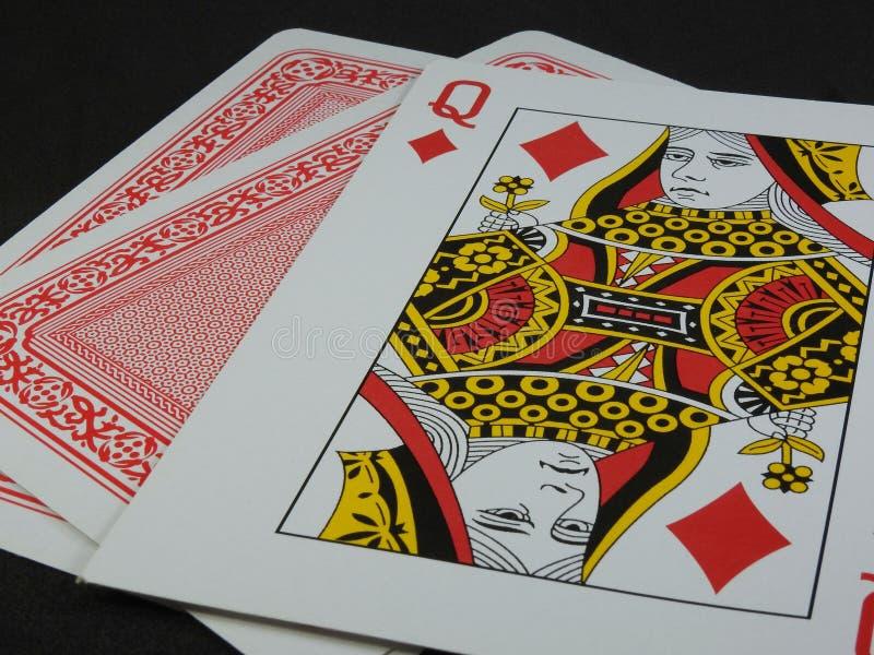 Tre spela kort Drottningen av diamanter vänder mot upp arkivfoton