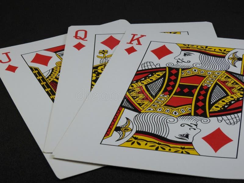 Tre spela kort: Konung, drottning och stålar av diamanter royaltyfria bilder
