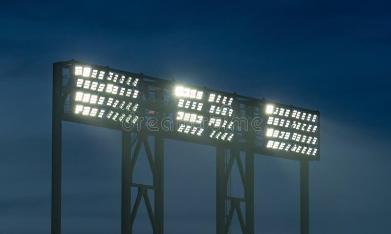 Tre stadionljus som översvämmar ett idrotts- fält fotografering för bildbyråer