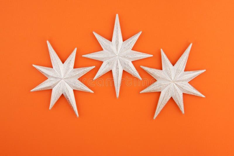 Tre stelle dell'argento della decorazione di natale fotografie stock
