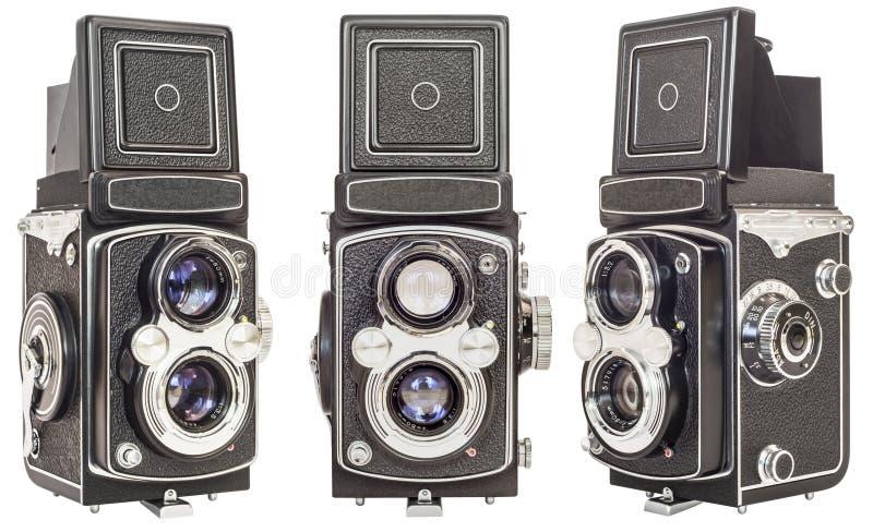 Tre stessi rendono a vecchia lente gemellata le macchine fotografiche reflex isolate su fondo bianco immagini stock