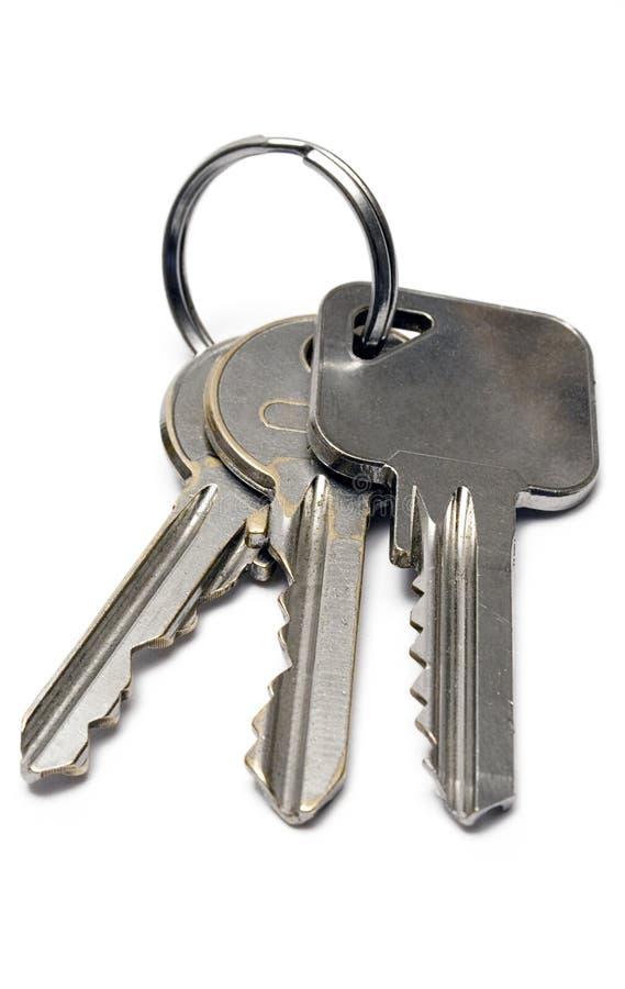 Tre tasti dell'appartamento con l'anello (vista frontale) fotografia stock libera da diritti