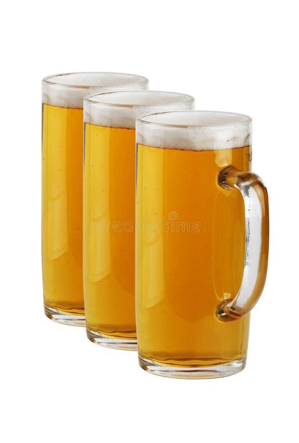 Tre tazze di birra immagini stock