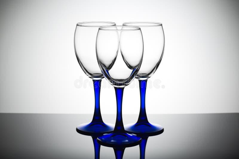 Tre tomma exponeringsglas på en vit bakgrund royaltyfri foto