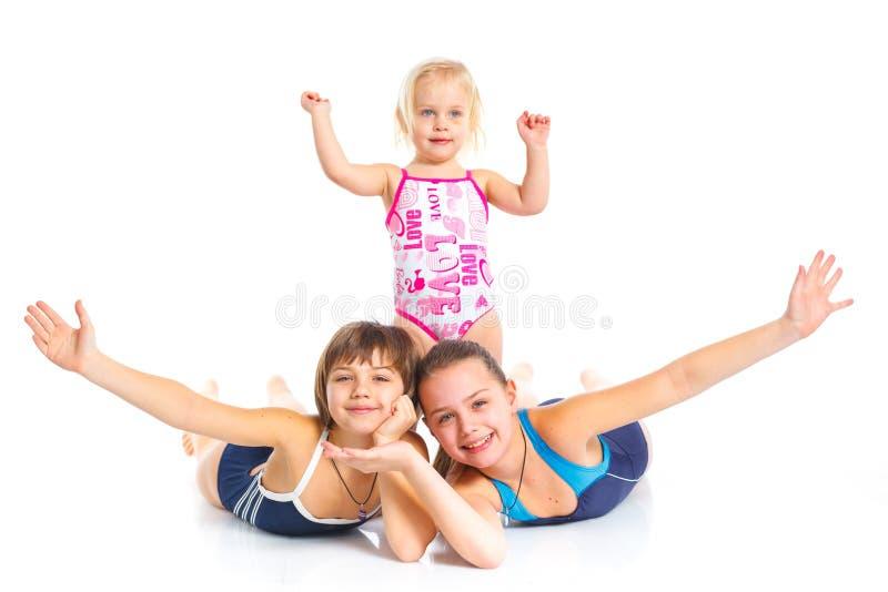 Tre unga härliga flickor royaltyfri foto