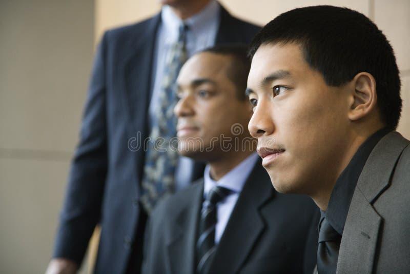 Tre uomini d'affari fotografie stock