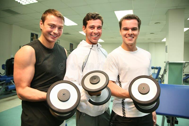 Tre uomini di ginnastica immagine stock