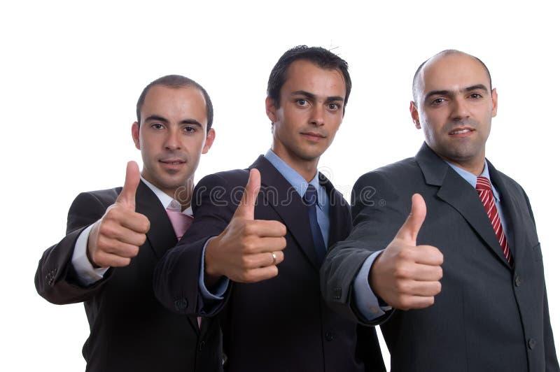 Tre uomini positivi di affari fotografie stock libere da diritti