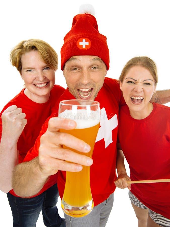 Tre upphetsade schweiziska sportfans fotografering för bildbyråer