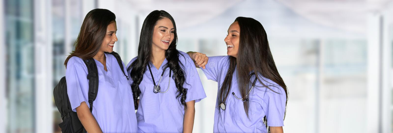 Tre vårda studenter royaltyfri foto