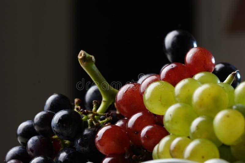 Tre varietà dell'uva immagini stock