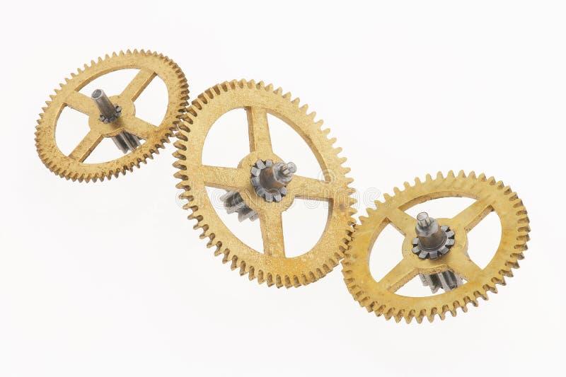 Tre vecchie ruote dentate dorate immagini stock libere da diritti