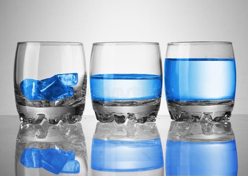 Tre vetri con acqua e ghiaccio immagine stock libera da diritti