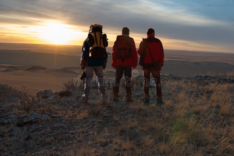 Tre viaggiatori immagine stock