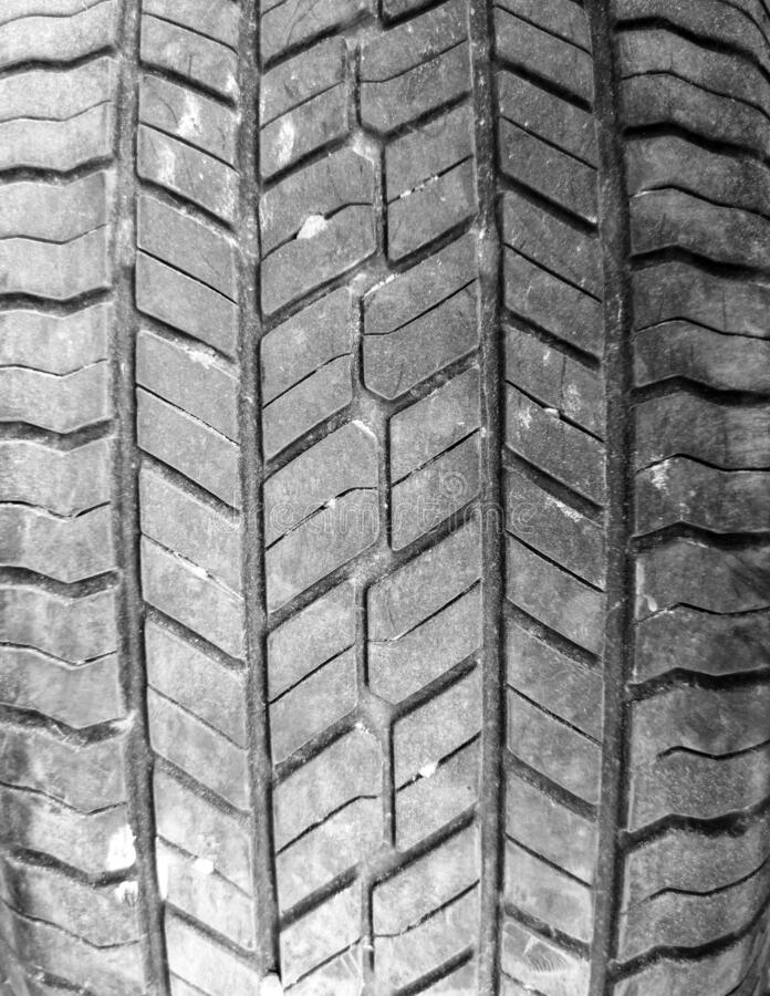 Tread on a car wheel as an abstract background stock images