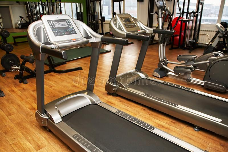 Treadmill in a gym. Fitness club equipment. Sports background. stock image