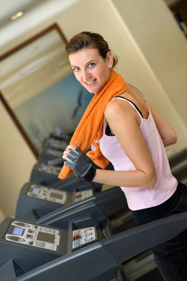 Download Treadmill Woman With Orange Towel Stock Images - Image: 12994334