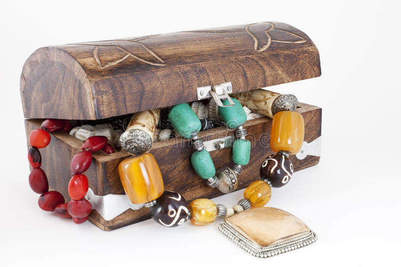 Treasure. Chest full of jewelry isolated on white background stock photography