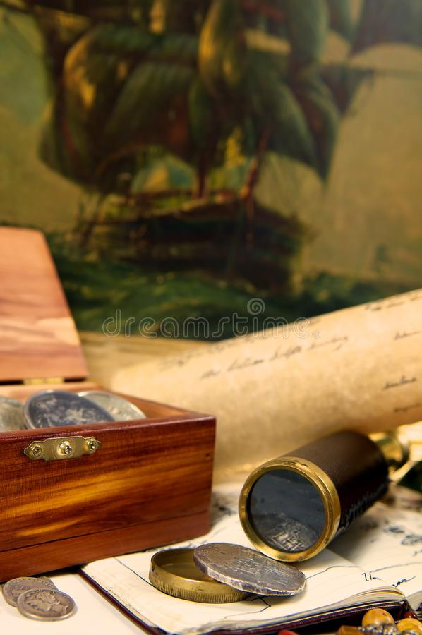 Treasure. An adventurous scene of exploration. Filled with maps, spanish silver, and a trusty telescope. Could this be desk of a captain, or a pirate perhaps stock images