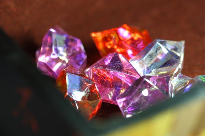 Treasure. Gems in wood box stock image