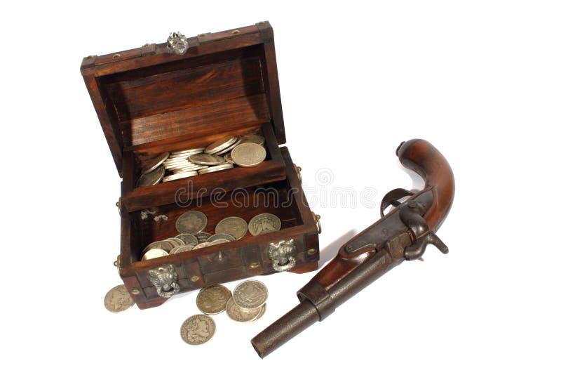 Treasure Box and Pistol royalty free stock photos