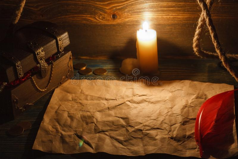 Treasure chest end old empty paper on a wooden table. stock photo