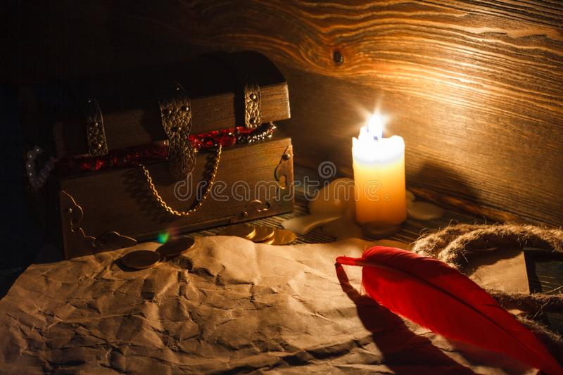 Treasure chest end old empty paper on a wooden table. royalty free stock image