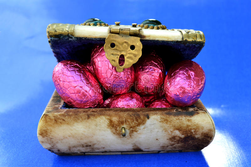 Treasure Chest Full with Chocolate Easter Eggs stock image