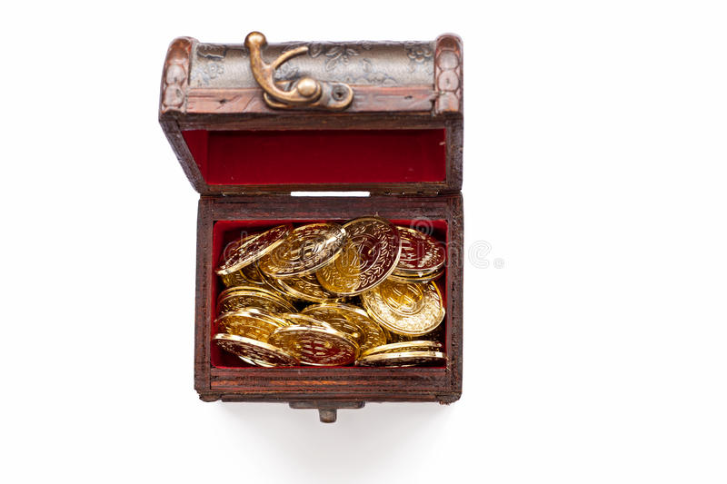 Treasure chest with gold coins on white royalty free stock photos