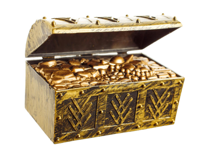 Treasure chest. Open treasure chest with shinny gold isolated royalty free stock photography