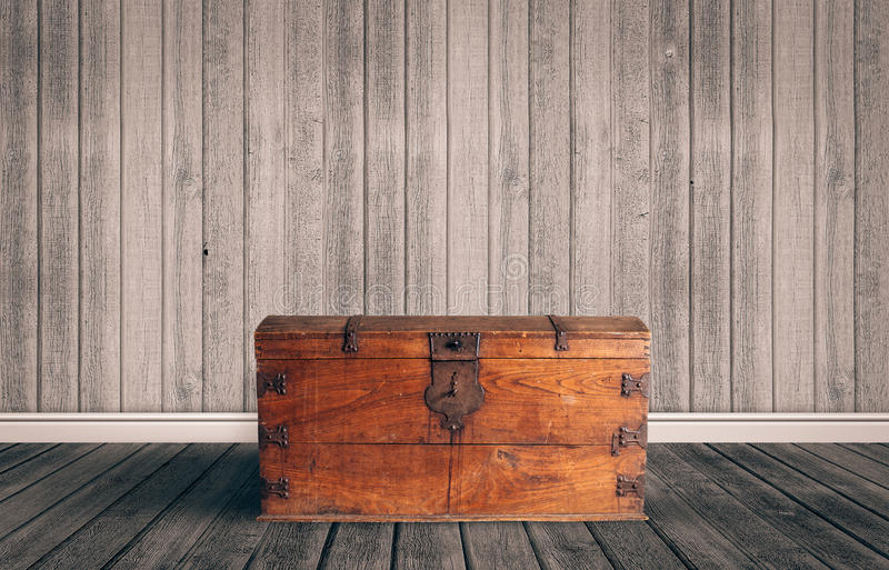 Treasure chest on a wooden floor royalty free stock photography