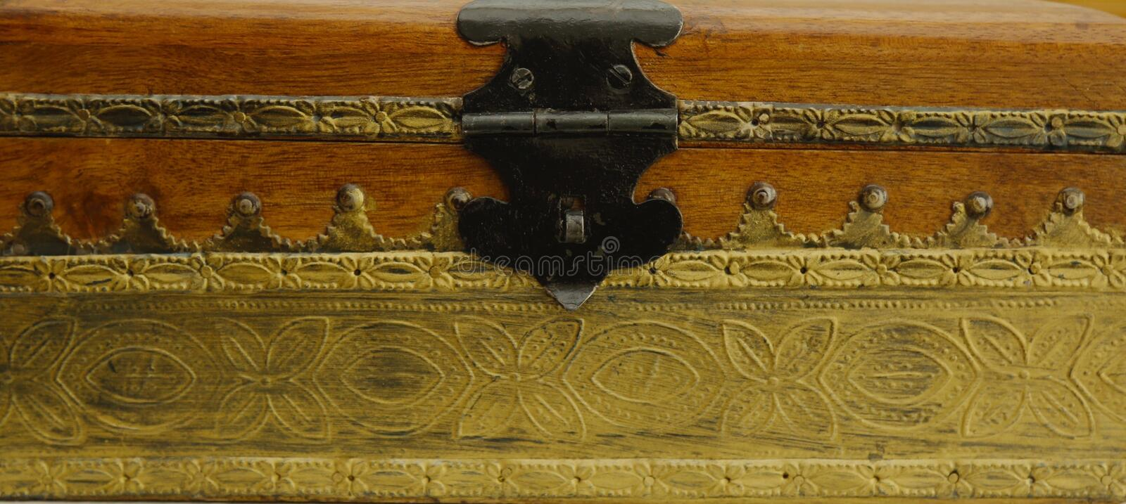 Treasure chest. Wooden treasure chest with gold trim decoration stock photo