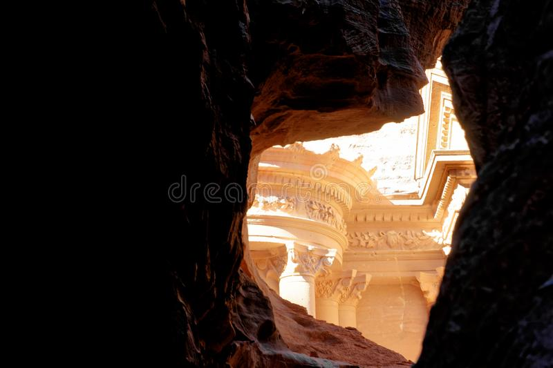 The treasure house of Petra from a perspective between the rocks in Wadi Musa, Petra, Jordan stock image