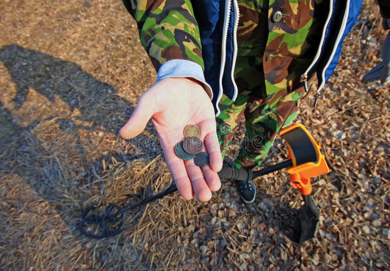 Treasure hunter. Searching with metal detector. royalty free stock photography