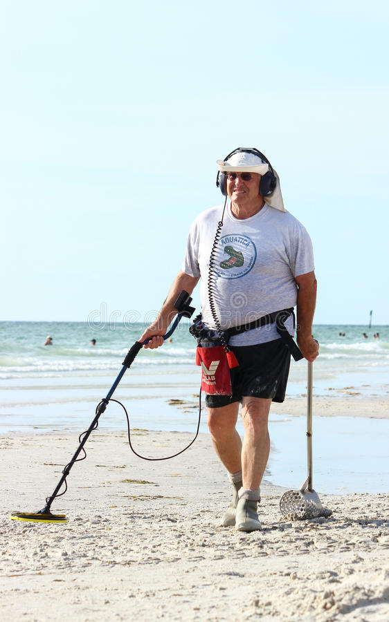 Treasure hunting at the beach editorial image image for Florida fishing license for seniors