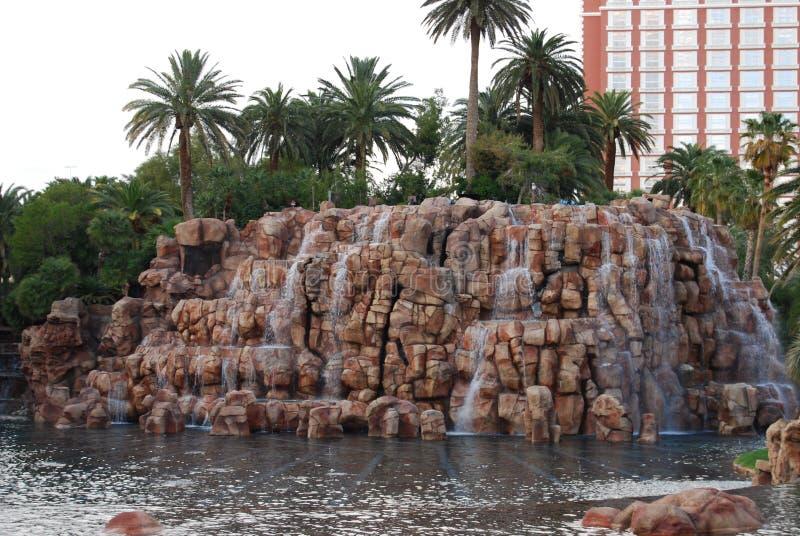 Treasure Island Hotel and Casino, water, rock, arecales, tree. Treasure Island Hotel and Casino is water, tree and African elephant, Loxodonta africana. That stock photo