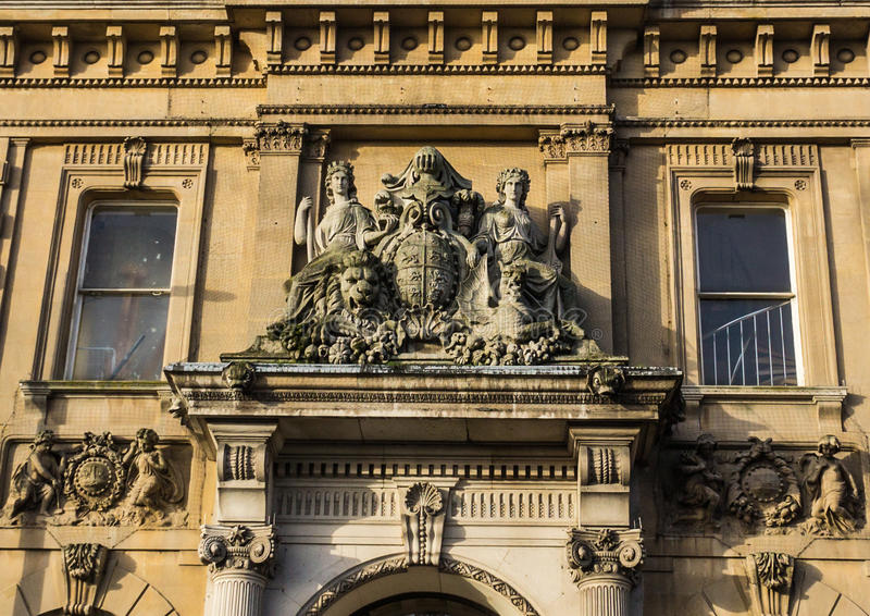 The Treasury Sculptures. The Treasury restaurant was designed in 1875 for the National Provincial Bank of England by architect John Gibson. It is located in royalty free stock photo