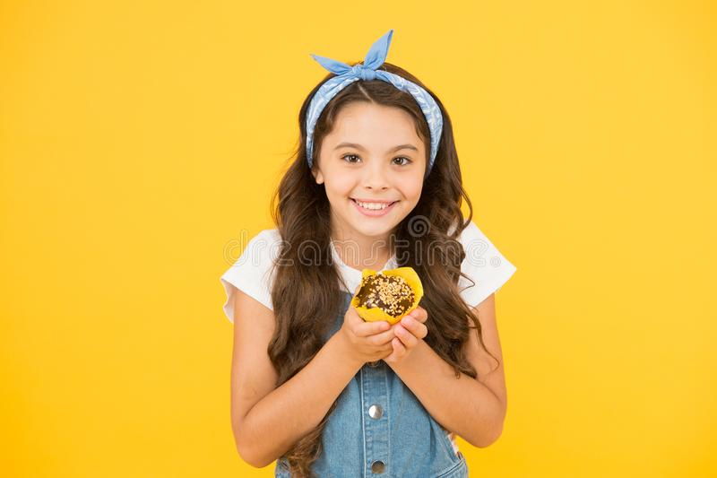Treat someone with sweets. Yummy cupcake. Homemade muffin. Happy childhood. Bakery confectionery concept. Kid girl hold royalty free stock photography